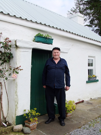 Danny Meehan outside his restored family home in Donegal, June 2012. Photograph by Sara Goek.